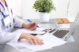 blue-fingernails-medical-desk
